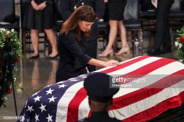 Former Senator Kelly Ayotte touches the casket of the late US Senator John McCain inside the Rotunda of the US Capitol August 31 2018 in Washington...