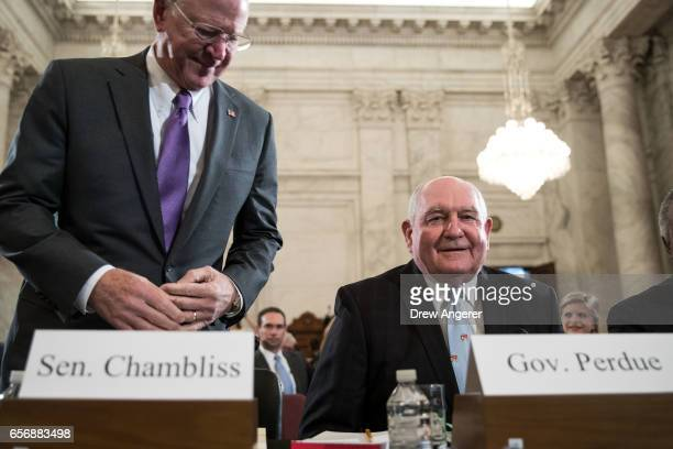 Former Senator Saxby Chambliss and Sonny Perdue President TrumpÕs nominee to lead the Agriculture Department arrive for Perdue's confirmation hearing...