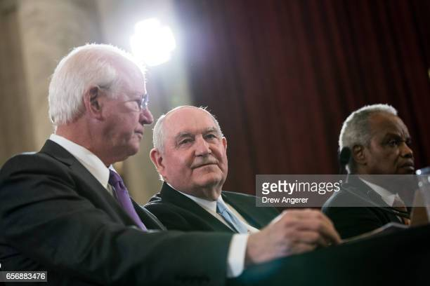 Former Senator Saxby Chambliss delivers opening remarks as Sonny Perdue President TrumpÕs nominee to lead the Agriculture Department and Rep David...