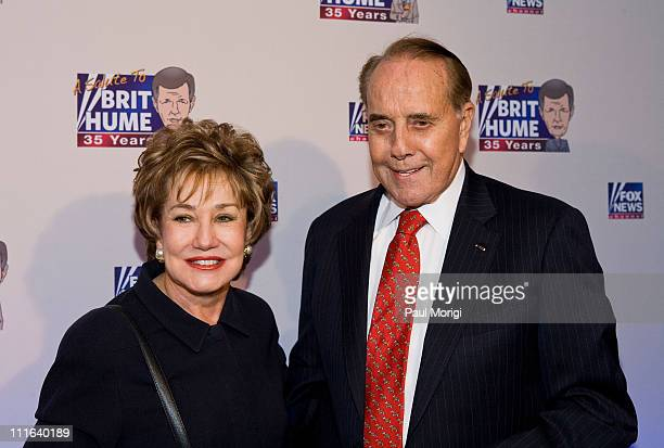 Former Sens Elizabeth Dole and Bob Dole attend salute to Brit Hume at Cafe Milano on January 8 2009 in Washington DC
