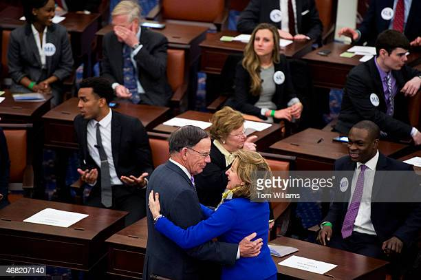Former Sens Paul Kirk DMass and Kay Hagan DNC talk during an opening ceremony for a lifesize replica of the Senate Chamber that was part of the...
