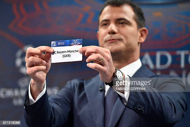 Former Serbian midfielder and 2016 UEFA Champions League final ambassador Dejan Stankovic shows the name of Bayern Munich during the semi-final draw...
