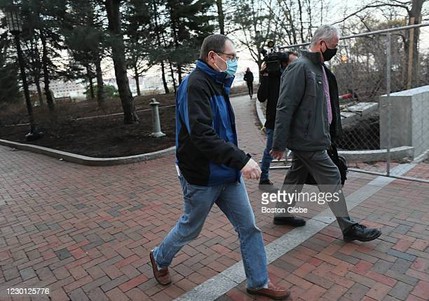 Former sergeant William W. Robertson of Westborough, left, leaves the Moakley Federal Courthouse in Boston on Dec. 11, 2020. He pleaded not guilty to...
