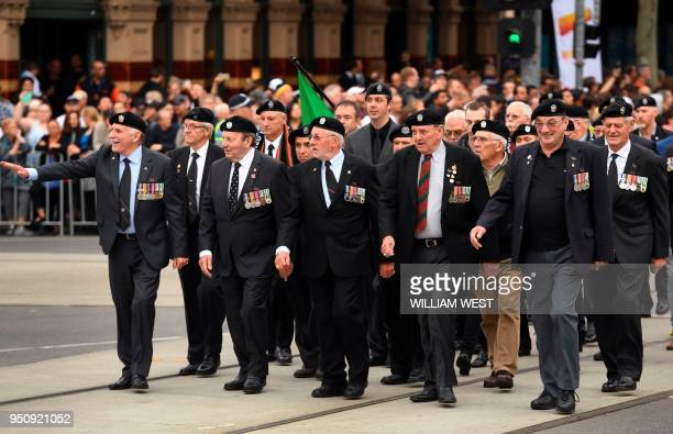 Former servicemen march during the Anzac Day parade in Melbourne on April 25, 2018. - Tens of thousands of Australians and New Zealanders turned out...