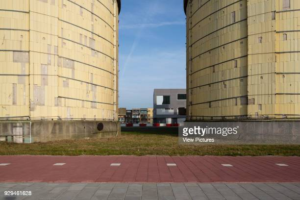 Former sewage treatment plant silos with houses in background Zeeburgeiland Amsterdam Zelfbouw series extras Various Netherlands Architect various...