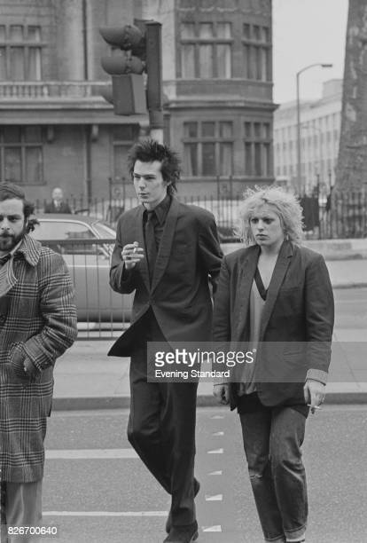 Former Sex Pistols bassist Sid Vicious with his girlfriend Nancy Spungen arriving at Marylebone Magistrates Court London 9th February 1978