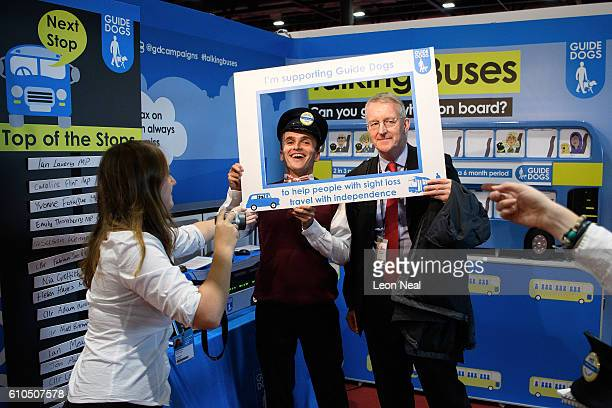 Former shadow foreign secretary Hilary Benn poses for a photo on the RNIB exhibition stand on the second day of the Labour Party conference on...