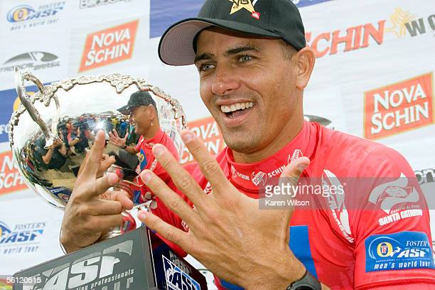 Former six times ASP world champion Kelly Slater celebrates his seventh world title after his closest rival reigning three times ASP world champion...