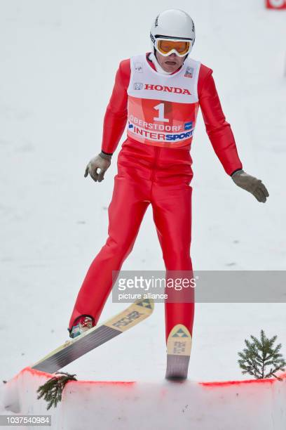 Former ski jumper Michael Edwards known as Eddie 'The Eagle' takes a jump during the first stage of the Four Hills ski jumping tournament in...
