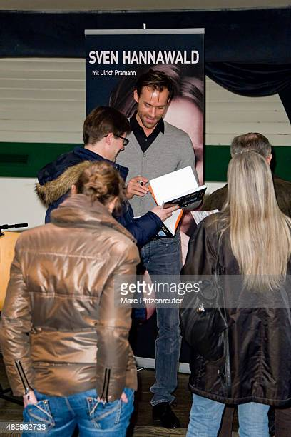 Former ski jumper Sven Hannawald autographs his book 'Mein Hoehenflug mein Absturz meine Landung im Leben' at the Thalia Bookstore on January 30 2014...