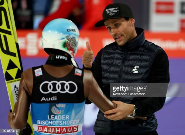 Former ski jumper Sven Hannawald of Germany congrats Kamil Stoch of Poland after the FIS Nordic World Cup Four Hills Tournament on January 6 2018 in...