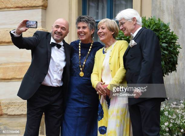 Former skiers Rosi Mittermaier and Christian Neureuther pose with Bayreuth's mayor Brigitte MerkErbe and her husband Thomas Erbe at the Festival...