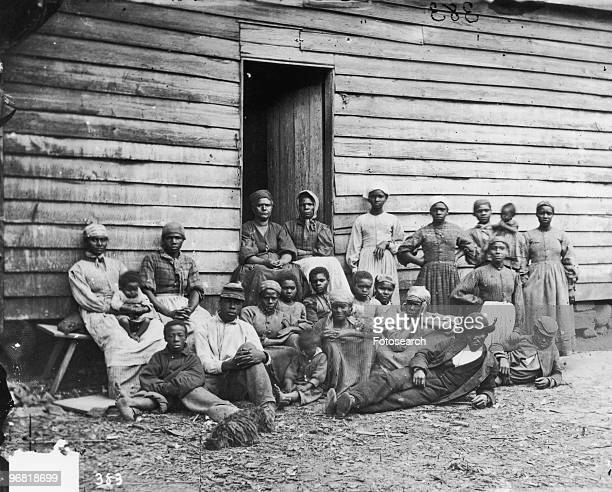 Former Slaves sit at Foller's House in Cumberland Landing Virginia circa 1850