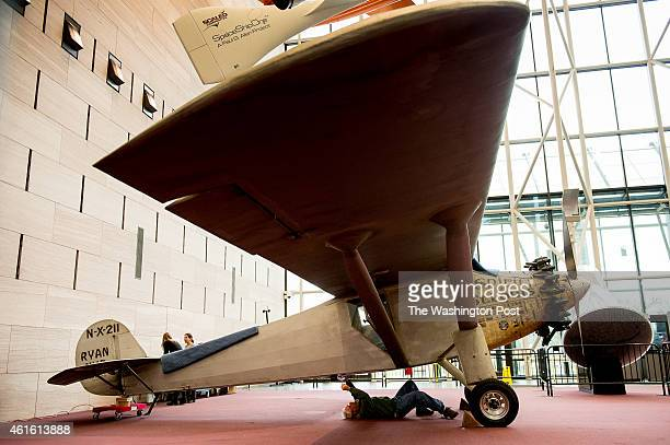 Former Smithsonian employee Karl Heinzel who originally helped reassembled the airplane at the museum in the 1970s inspects the iconic Spirit of St...