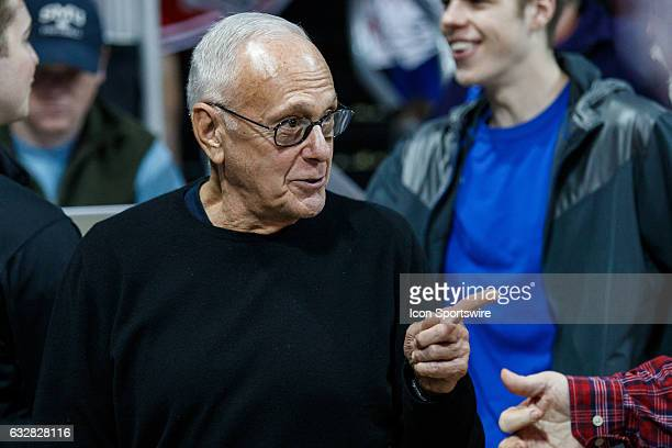 Former SMU head coach Larry Brown talks to a fan during the American Athletic Conference college basketball game between the SMU Mustangs and the...