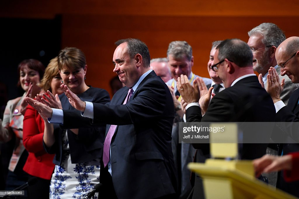 Former SNP leader Alex Salmond is given a standing ovation as Nicola Sturgeon, gives her first key note speech as SNP party leader at the partys annual conference on November 15, 2014 in Perth, Scotland. Nicola Sturgeon formally took over the leadership of the SNP from Alex Salmond yesterday, during her speech she urged voters to leave Labour in next May's UK election.
