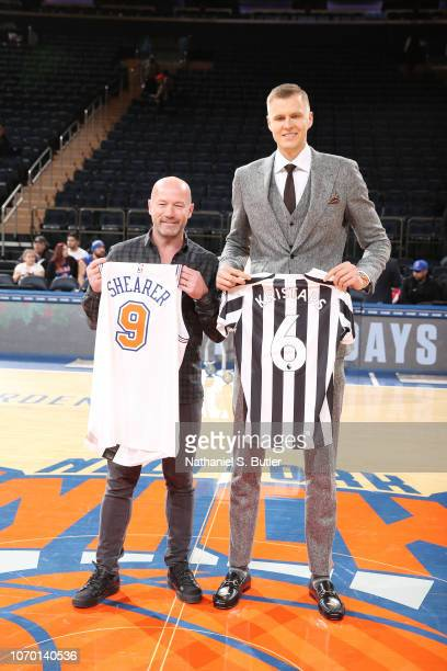 Former Soccer Player Alan Shearer and Kristaps Porzingis of the New York Knicks swap jerseys prior to the game against the Brooklyn Nets on December...