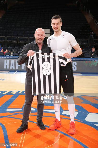 Former Soccer Player Alan Shearer and Mario Hezonja of the New York Knicks swap jerseys prior to the game against the Brooklyn Nets on December 8...