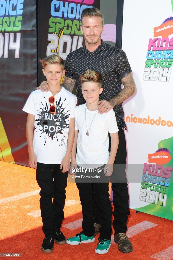 Former soccer player David Beckham, Romeo James Beckham (L) and Cruz David Beckham attend Nickelodeon Kids' Choice Sports Awards 2014 at Pauley Pavilion on July 17, 2014 in Los Angeles, California.