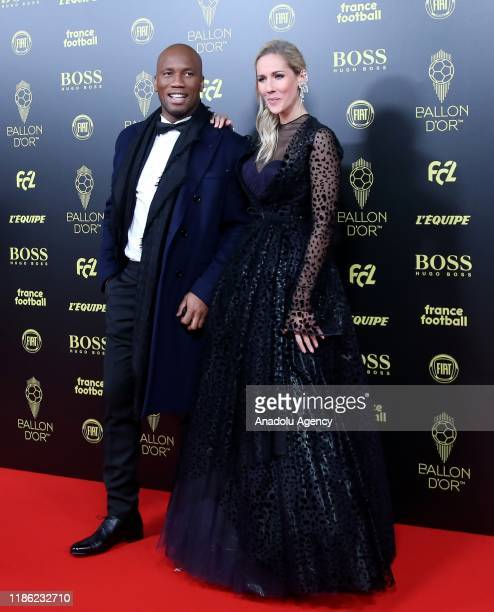 Former soccer player Didier Drogba and French journalist Sandy Heribert arrive to attend for the Ballon d'Or ceremony at Theatre du Chatelet in Paris...