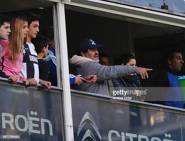 Former soccer player Diego Maradona and his daughter Jana Maradona during a match between Boca Juniors and Quilmes as part of 17th round of Torneo...