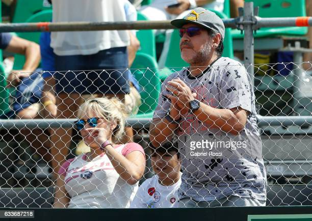 Former soccer player Diego Maradona looks on during a singles match between Guido Pella and Paolo Lorenzi as part of day 1 of the Davis Cup 1st round...
