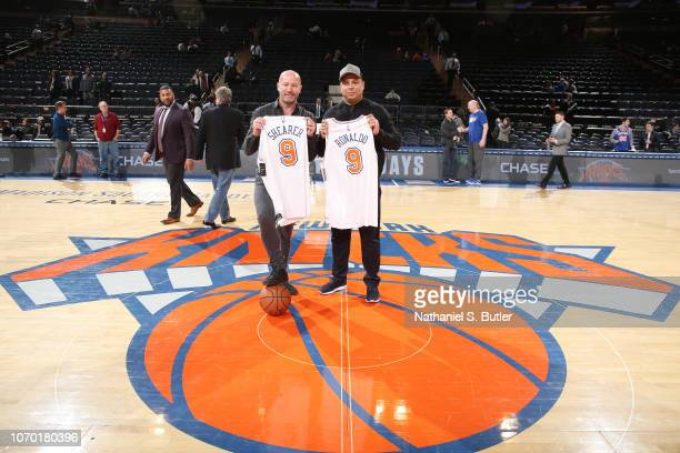 Former Soccer Players Alan Shearer and Ronaldo pose for a photo prior to the game between the New York Knicks and Brooklyn Nets on December 8 2018 at...