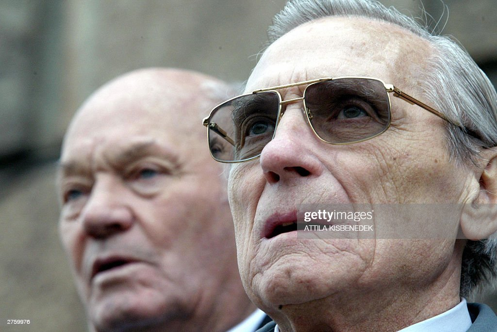 Former soccer players Jeno Buzanszky (L) and Gyula Grosics (R), two of the three living former Hungarians who played in the historical 'Match of 20th century' between England and Hungary at Wembley Stadium in London on 25 November 1953, stand in front of a Hungarian Soccer Player monument in Budapest 25 November 2003 during 50th anniversary celebrations of Hungary's 6-3 win.