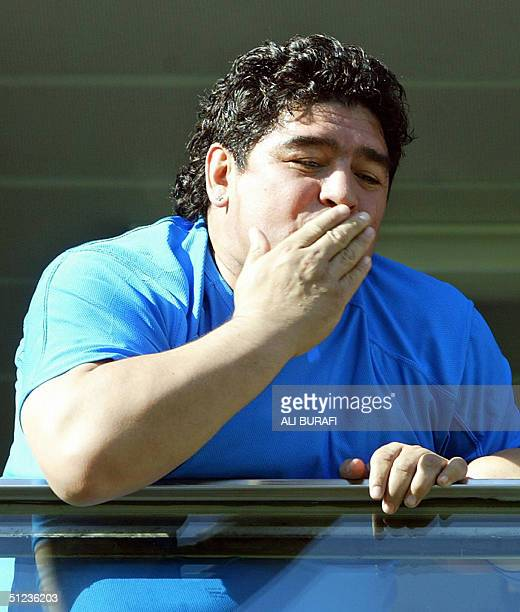 Former soccer star and Boca Juniors player Diego Armando Maradona blows a kiss 29 August 2004 at Boca Juniors' La Bombonera field in Buenos Aires...