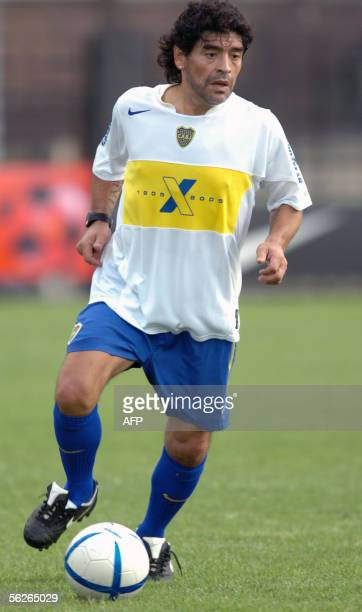 Former soccer star Argentine Diego Maradona drives the ball during a friendly match between of Boca Juniors and Argentinos Juniors' veteran players...