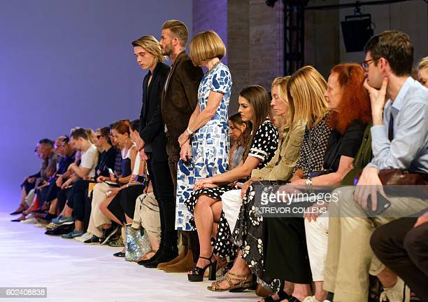 Former soccer star David Beckham stands at attention flanked by his son Brooklyn and Vogue magazine editor Anna Wintour during a moments silence in...