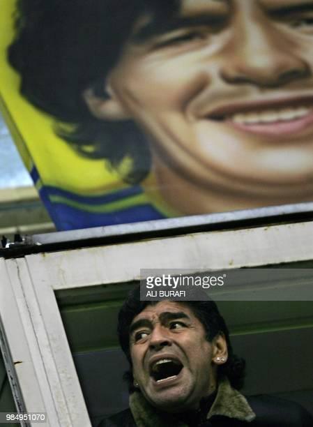 Former soccer star Diego Maradona cheers Boca Juniors team during the first Recopa Sudamericana final match against One Caldas from Colombia in...