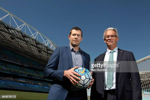 Former Socceroo Brett Emerton and FFA CEO David Gallop pose during an FFA Socceroos announcement at ANZ Stadium on September 7, 2017 in Sydney,...