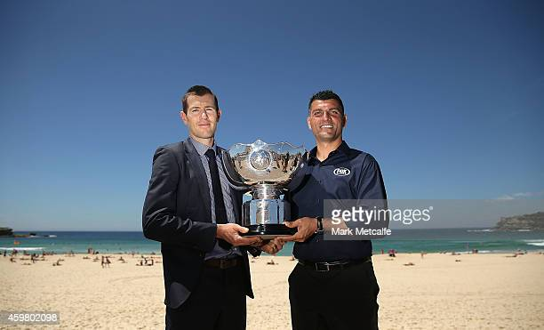 Former Socceroos Brett Emerton and John Aloisi pose with the Asian Cup trophy during the Fox Sports Asian Cup coverage launch at Bondi Beach on...