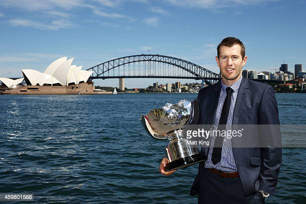 Former Socceroos Brett Emerton poses with the Asian Cup trophy during the Asian Cup Trophy Tour at Sydney Harbour on December 2 2014 in Sydney...