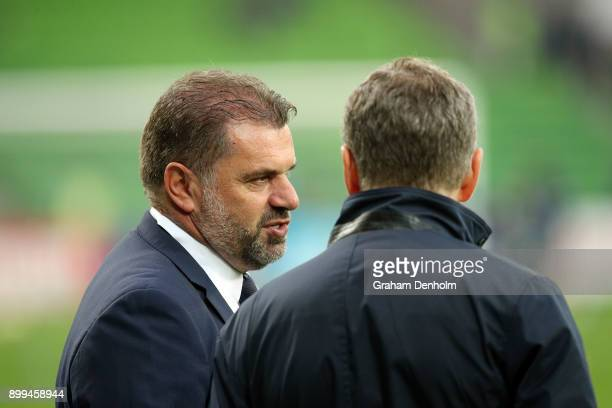 Former Socceroos Head Coach Ange Postecoglou talks to Newcastle Jets Head Coach Ernie Merrick prior to the round 13 ALeague match between the...