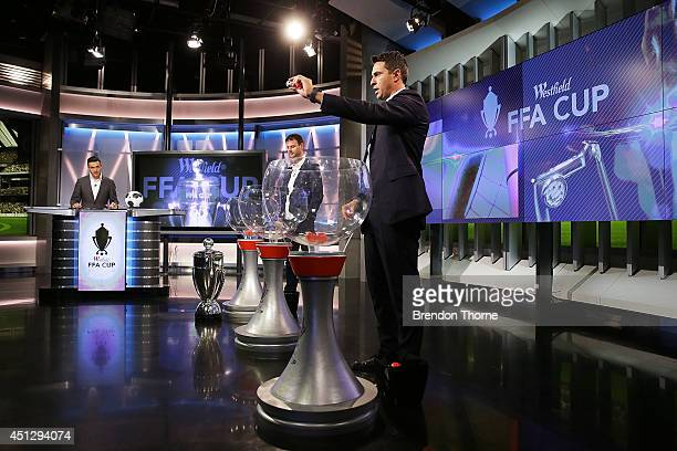 Former Socceroos Paul Okon and Mile Sterjovski draw teams to compete in the official FFA Cup draw at Fox Sports Studios on June 27 2014 in Sydney...