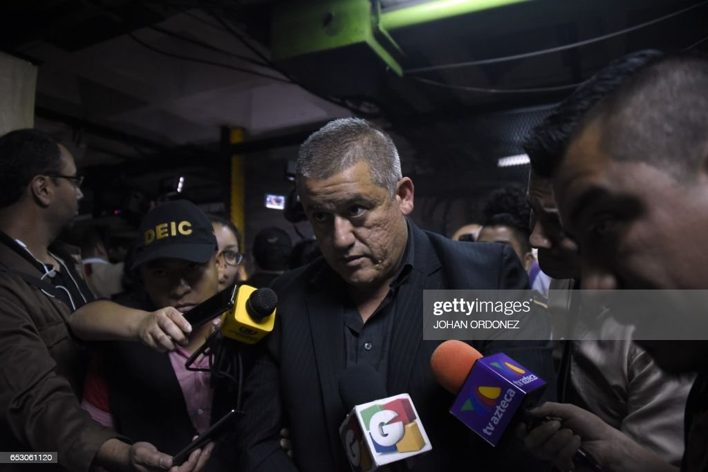 Former Social Welfare Secretary Carlos Rodas is escorted by police agents to a courtroom after being arrested in connection with the fire at a children's shelter that killed 40 girls in Guatemala C...