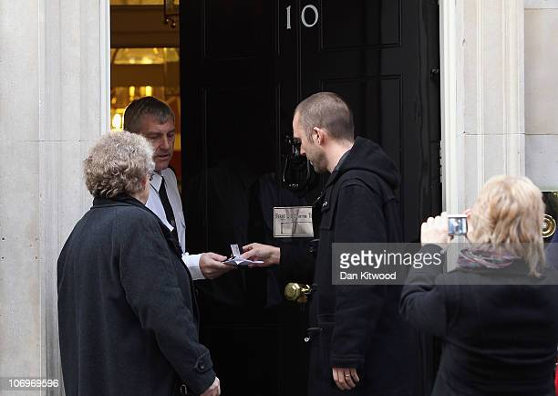 Former soldier Joe Glenton who served with the Royal Logistic Corps hands his campaign medal in after arriving in Downing Street on November 19 2010...