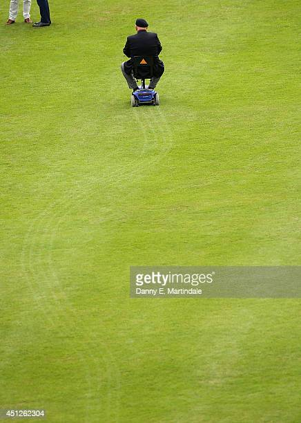 A former soldier rides his mobility scooter across the Buckingham Palace lawn during a Garden Party at Buckingham Palace on June 6 2013 in London...