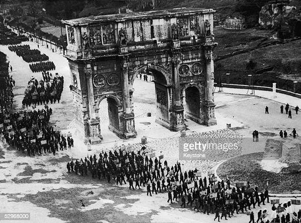 20000 former soldiers march along the new road of Triumph in Rome past the Arch of Constantine to celebrate the 11th anniversary of the March on Rome...