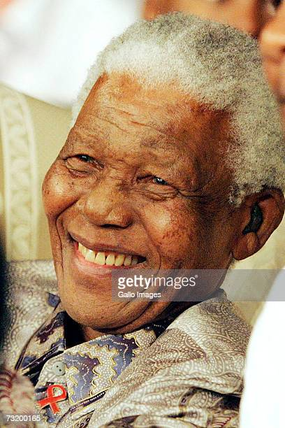 Former Soputh African President Nelson Mandela watches Lalia Ali of USA defeating Gwendolyn O'Neil of Guyana during the WBC/WIBA Super Middleweight...