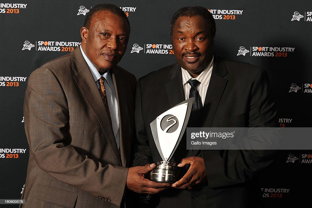 Former South Africa football legend Jomo Sono (R) receives the Johnnie Walker Lifetime Achievement Award from SA Soccer Administrator Irvin Kohza during the Virgin Active Sport Industry Awards 2013 held at Emperors Palace on February 07, 2013 in Johannesburg, South Africa.