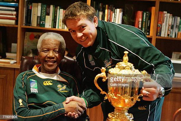 Former South Africa President Nelson Mandela poses with South Africa Rugby Union captain John Smit and the WebbEllis cup during the Springboks visit...