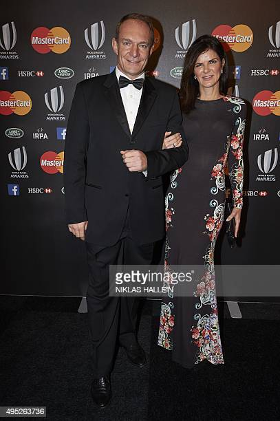 Former South Africa rugby captain Francois Pienaar and his wife Nerine pose on arrival at the World Rugby Awards in London on November 1 2015 AFP...