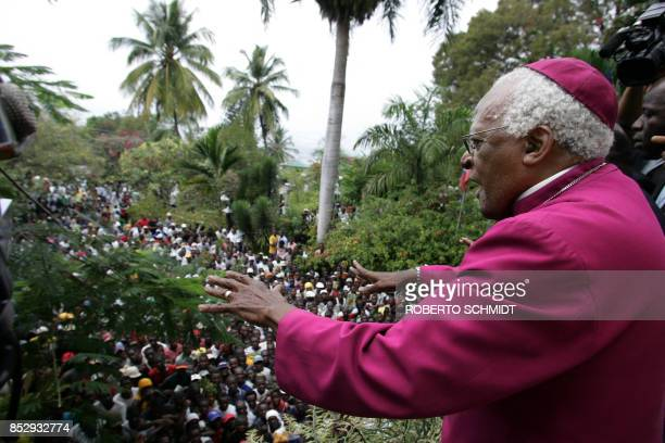 Former South African Anglican Archbishop and Nobel peace laureate Desmond Tutu tries to appease a crowd of Haitians who stormed a hotel where the...