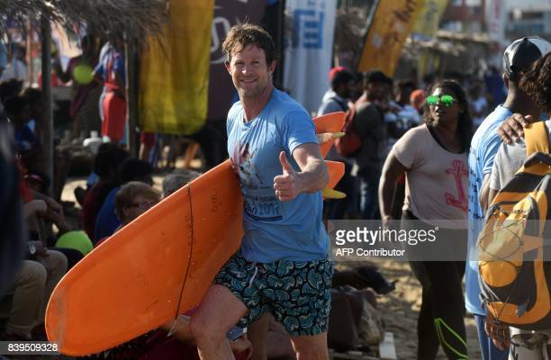 Former South African cricketer Jonty Rhodes gestures during the annual Covelong Point Classic Surf festival at Kovalam on the outskirts of Chennai on...