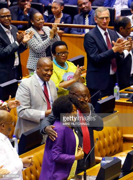 Former South African Deputy president Cyril Ramaphosa reacts as he hugs South African National Assembly speaker Baleka Mbete after being elected by...