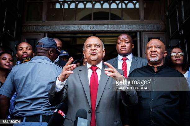 Former South African Finance Minister Pravin Gordhan and his deputy Mcebisi Jonas address a group of supporters outside the South African National...