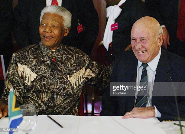 Former South African heads of state Nelson Mandela and FW de Klerk share a joke at a press conference as part of the FIFA 2010 World Cup Host...